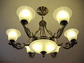 Beautiful bronze chandelier. — Stock Photo