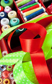 Sewing background. Set of multicolor bobbins, ribbons — Stock Photo