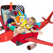 Little kid flying in travel suitcase packed for vacation — Foto de Stock