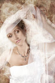 Bride in white veil at vintage background. — Stock Photo