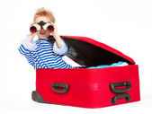 Kid with binoculars sail in suitcase — Stock Photo
