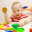 Happy child playing plasticine — Stock Photo #5377218