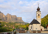 The Colfosco church and village, in italian Alps — Stock Photo