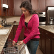 Foto Stock: Washing Dishes