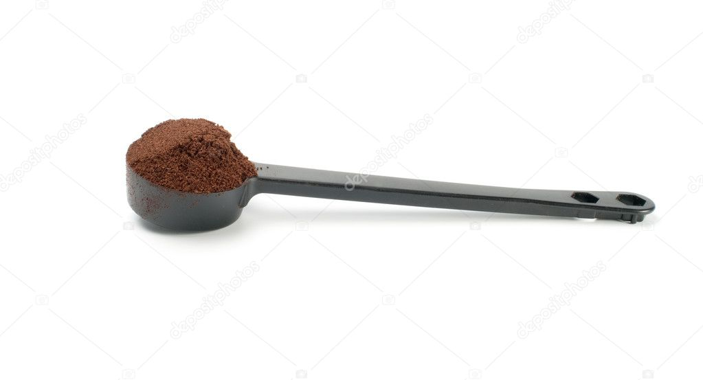  Coffee in  plastic  spoonon  white background  Stock Photo #5054788