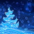 Christmas tree on a blue background — Stock Photo