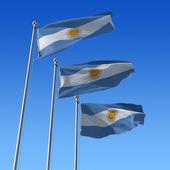 три флаги аргентины против голубого неба. — Стоковое фото