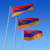 Three flags of Armenia against blue sky. — Stock Photo