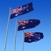 Three flags of Australia against blue sky. 3d illustration. — Stock Photo