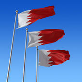 Three flags of Bahrain against blue sky. 3d illustration. — Stock Photo