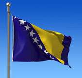 Flag of Bosnia and Herzegovina against blue sky. — Stock Photo