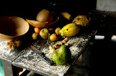 Old kitchen table with fruit — Stock Photo