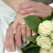 Stock Photo: Hands, rings and bouquet