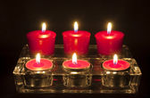 Six Red Tea Candles — Стоковое фото