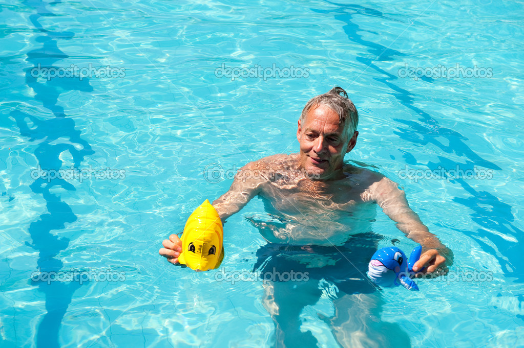 Retired man is playing in the swimming pool   Stock Photo #4028606