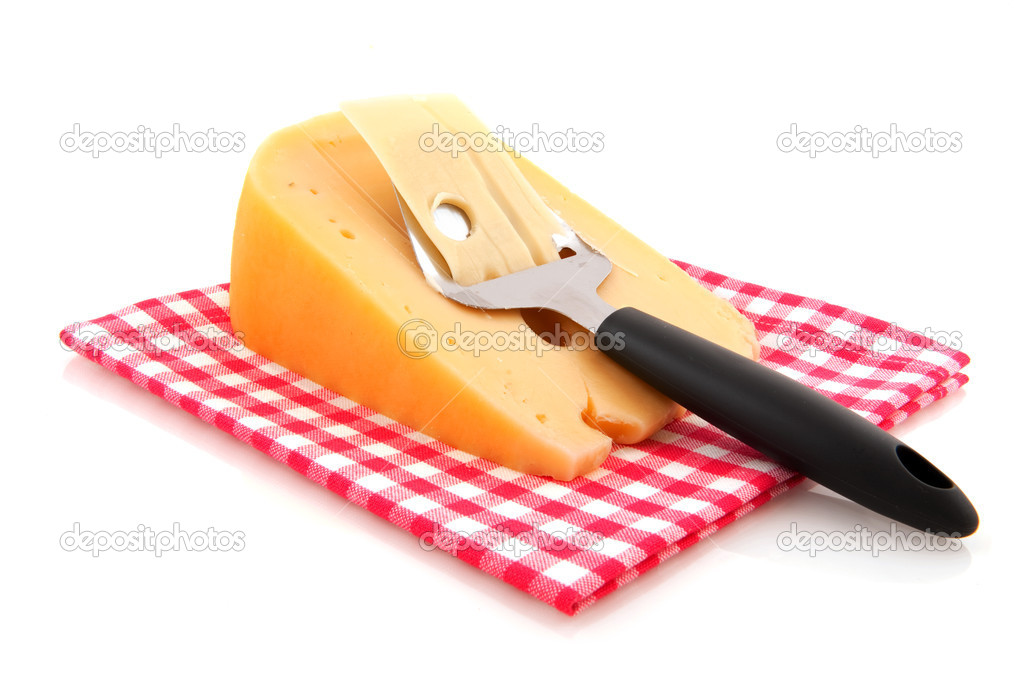 Dutch cheese with typical slicer isolated over white — Stock Photo #4028643