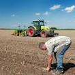Stock Photo: Farmer working in fields