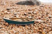 Rowboat at the beach — Stock Photo