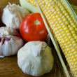 Stock Photo: Garlic tomate and maize