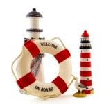 Lighthouse with life buoy — Stock Photo #4235463