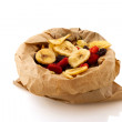 Paper bag with dried fruit — Stock Photo