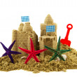 Sandcastle with starfishes — Stock Photo