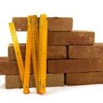 Bricks and measuring tool — Stock Photo