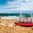 Fishing boat at the beach - Stock Photo