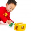 Chinese boy playing with puzzle — Stock Photo