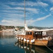 Wooden sail boat in harbor in San Feliu de Gauxols - Stock Photo
