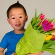 Child with flowers — Stock Photo #4890950