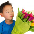 Asian boy with flowers — Stock Photo #4890964