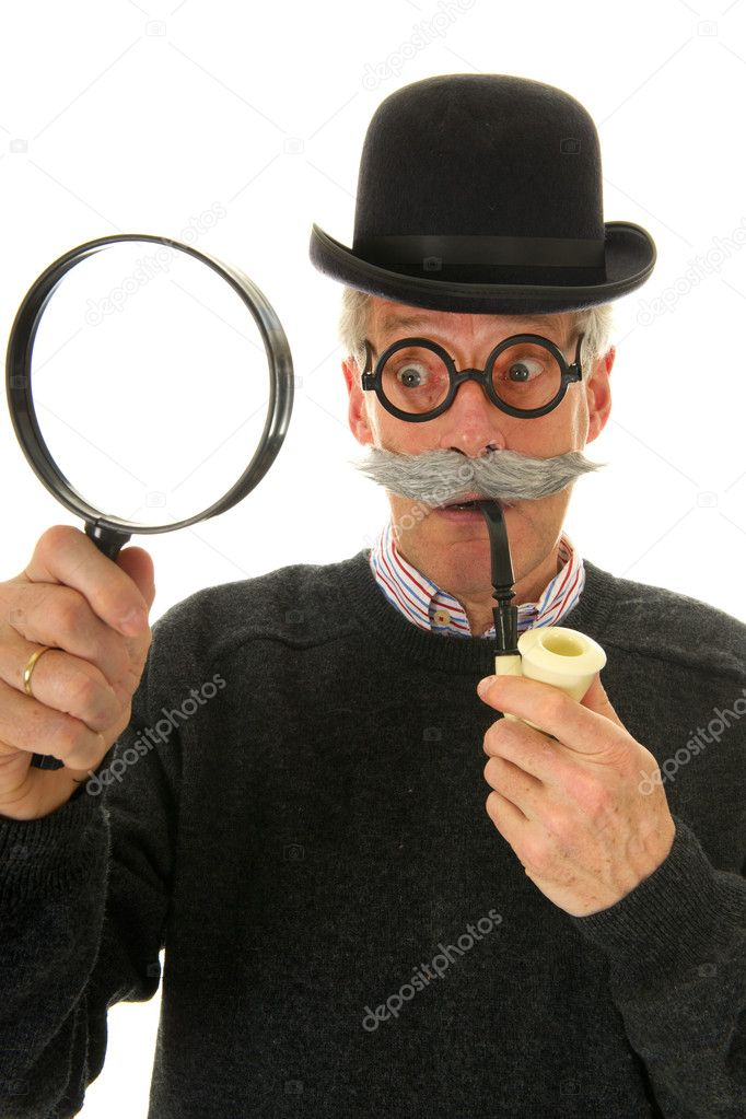 Portrait of a funny inspector with a big magnifier for investigation — Stock Photo #4890395