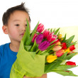 Asian boy with flowers — Stock Photo