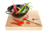 Red and green hot chili peppers — Stock Photo