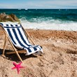 Empty chair at the beach - Stockfoto