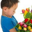 Asian boy with flowers — Stock Photo #5089977