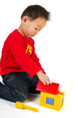 Chinese boy playing with toys — Stock Photo