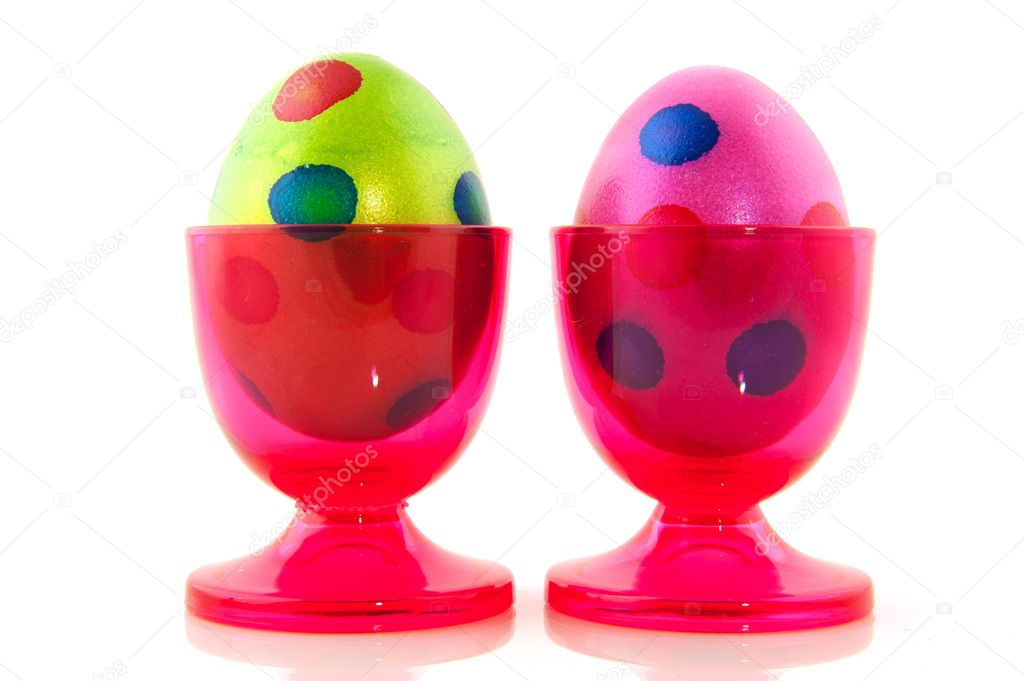 Colorful easter eggs in pink cups isolated over white — Stock Photo #5089475