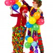 Stock Photo: Couple funny clowns with balloons