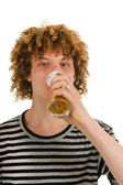Young boy is drinking beer — Stock Photo