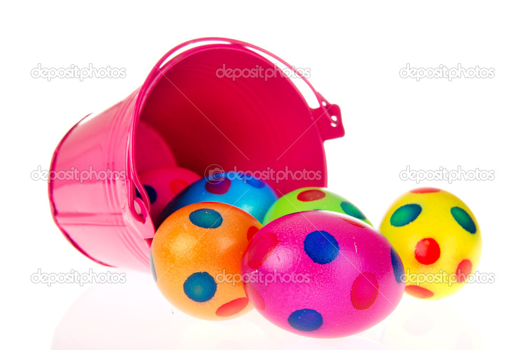 Pink bucket colorful easter eggs on white background — Stock Photo #5266091