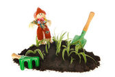 Gardening with scarecrow and tools — Stock Photo
