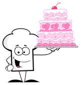 ピンクのケーキを保持しているシェフの帽子の男 — ストック写真