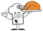 Kock hat killen som serverar en kalkon — Stockfoto