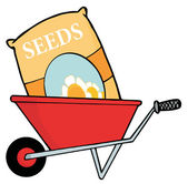 Bag Of Flower Seeds In A Wheel Barrow — Stock Photo
