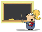 Middle Aged Blond Female Professor Pointing To A Chalk Board — Stock Photo