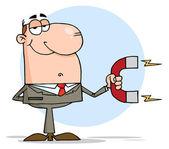 Glad affärsman med hjälp av en magnet — Stockfoto