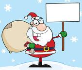 Santa hält ein leeren Zeichen im Schnee — Stockfoto