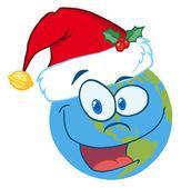 Nikolausmütze auf eine Erde-Cartoon-Figur — Stockfoto